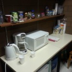 Microwave, kettle and coffee maker on table in sociology society office